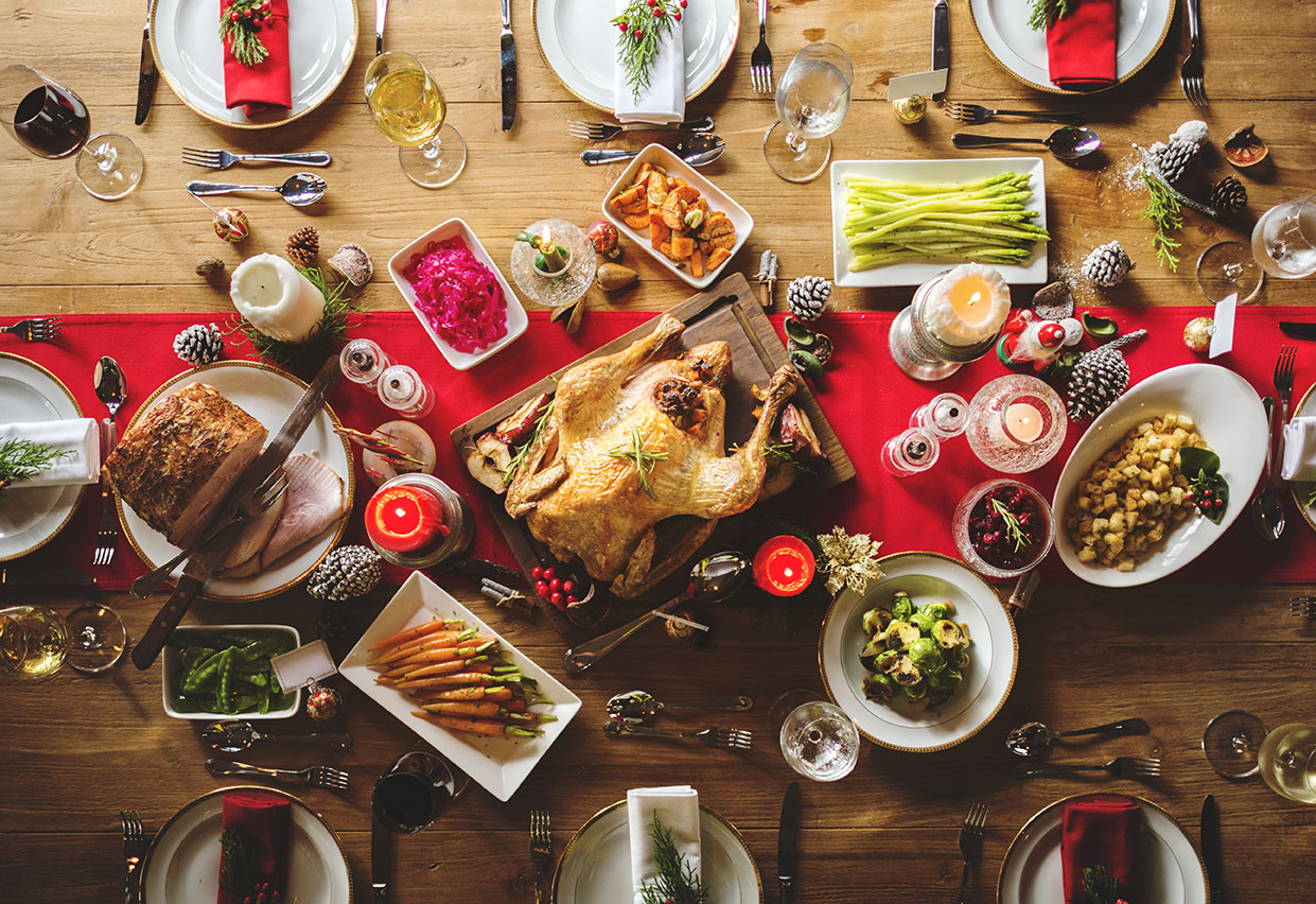 full thanksgiving meal on top of wooden table